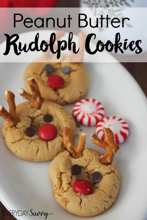Peanut butter cookie that look like Rudolph the red nosed reindeer on a white plate