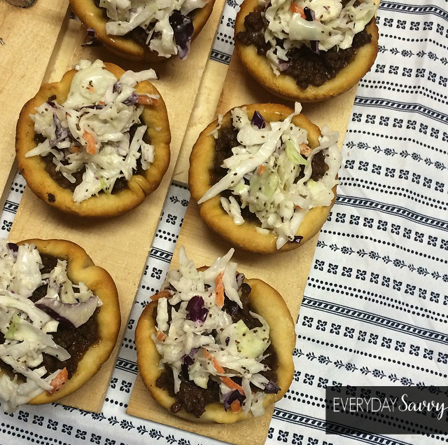 Check out this easy bbq beef sliders recipe with homemade Memphis slaw. These are hearty and the perfect snack at any party. You guests will love them! They are made with ground beef and a refrigerated canned biscuit base.
