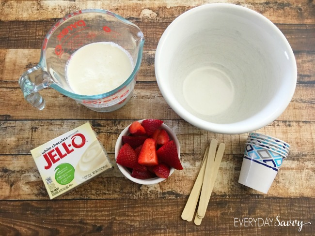 Easy Strawberry Jello Pudding Pops recipe. Requires just a few simple ingredients including fresh strawberries. Thes pudding pops are made in paper cups and so easy to make that kids can help. The hardest part is waiting for them to freeze.