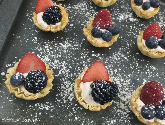 berry tarts with blueberry, strawberry and blackberry and powdered sugar