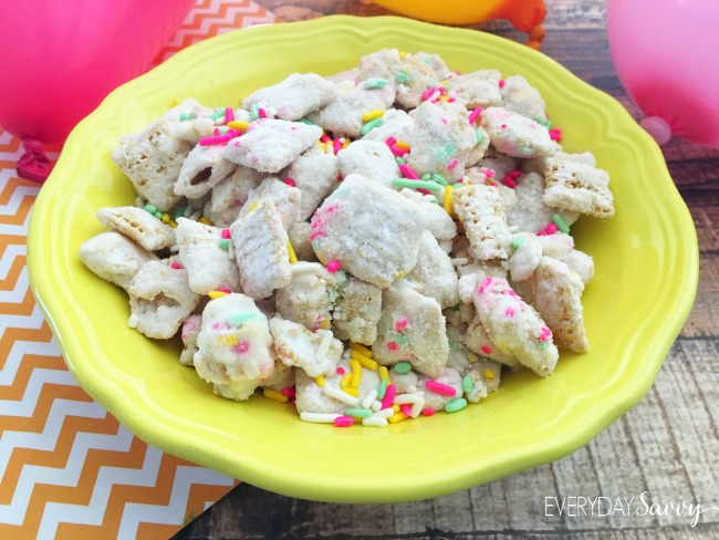 I am a huge fan of puppy chow recipes or Muddy Buddies as some people call them. This Cake Batter Puppy Chow Recipe is perfect for a party served in a colorful bowl