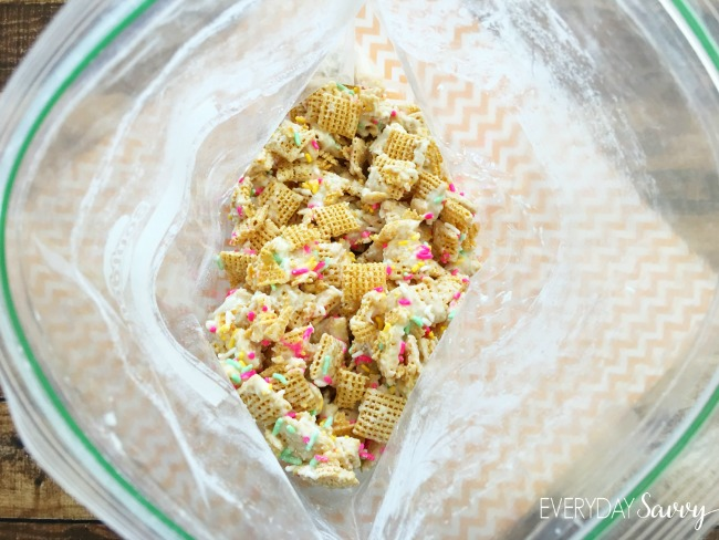 Mix up the Cake Batter puppy chow in a ziploc bag to coat with powdered sugar