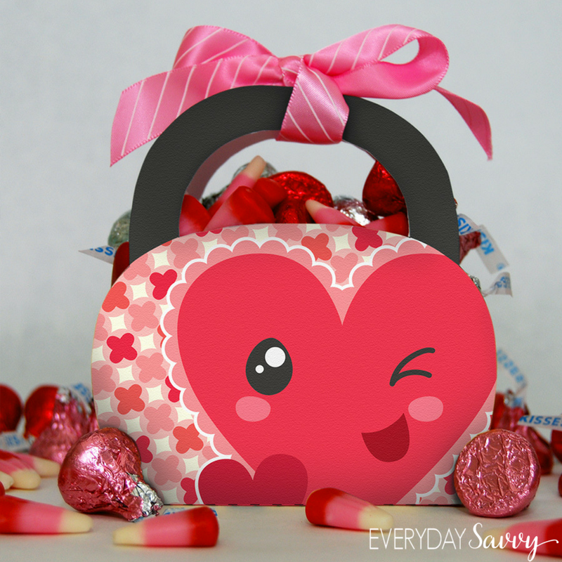 mini Valentine's Day Treat box with winking heart. Valentine's day candy pick Hershey kisses and white pink and red candy corn.