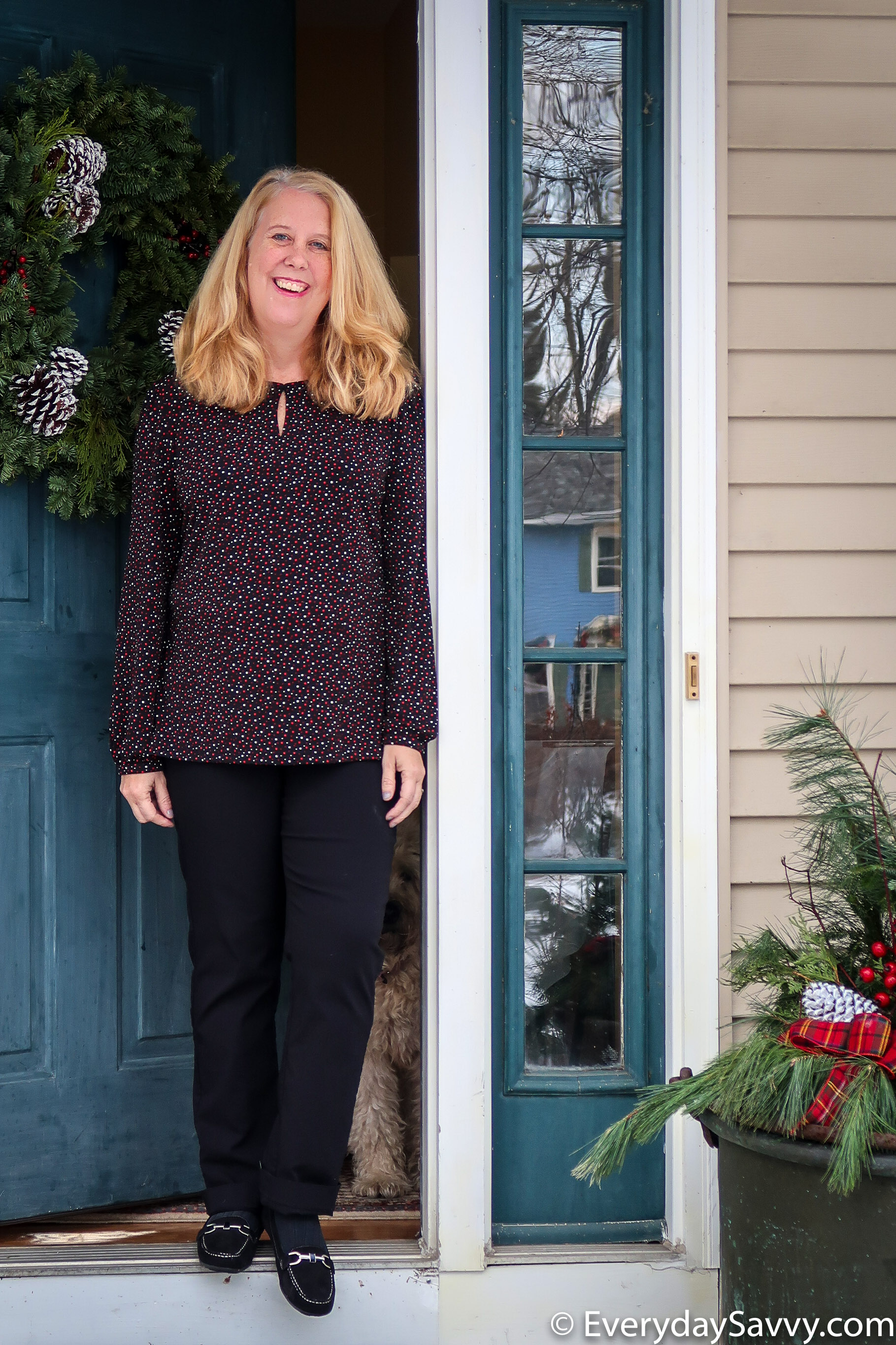 Cute holiday outfit - black printed blouse and black pants with loafers