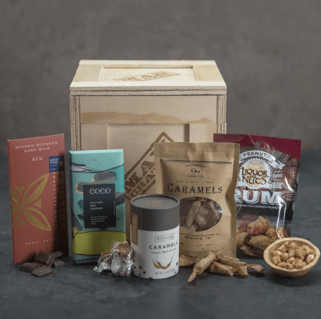 Booze-Infused Snacks Crate Caramel Single Malt Scotch (5.5 oz) Craft Beer & Pretzel Caramels Pouch (2.5 oz) Rum Peanuts (3 oz) Hudson Bourbon Chocolate Bar (2.12 oz) Gin & Tonic Chocolate Bar (2.82 oz)