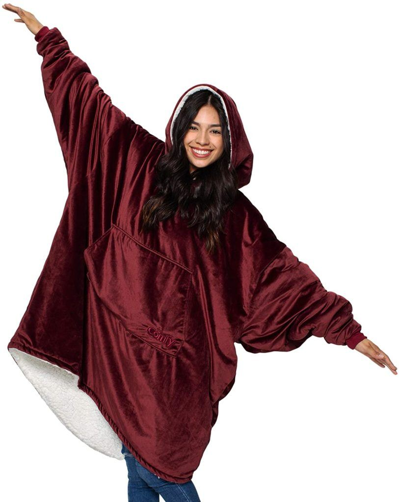 woman wearing oversized wearable blanket