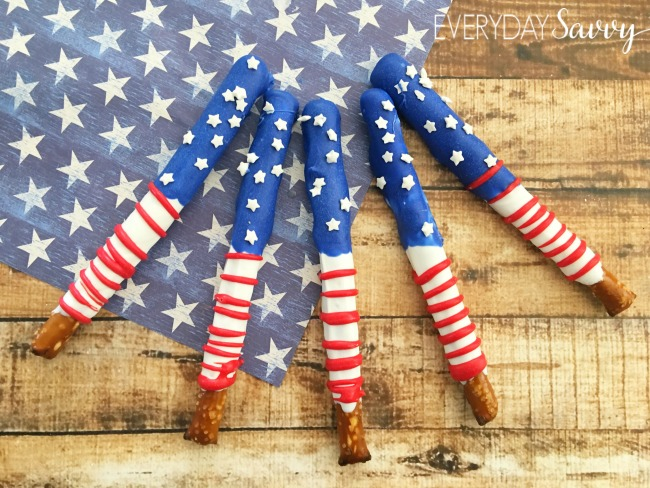 american flag inspired pretzel rods covered with red white and blue chocolate and white star sprinkles