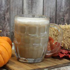 pumpkin spice latte in mug surrounded by fall decor