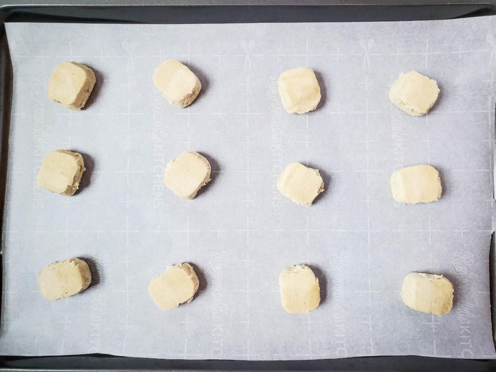 sugar cookie dough on baking sheet