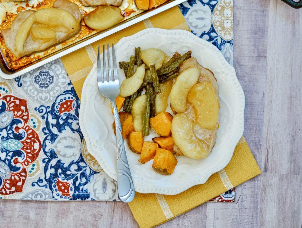 boneless pork chops sheet pan green beans sweet potato on plate easy dinner